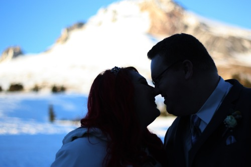 Sneaking another kiss as the sun sets on Mt. Hood.