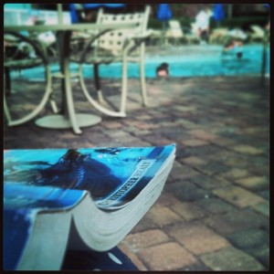 Reading 'The Hero's Guide to Being an Outlaw' poolside on my honeymoon to Walt Disney World earlier this year.
